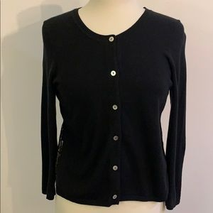 Anthropologie black cardigan with gold lace back.